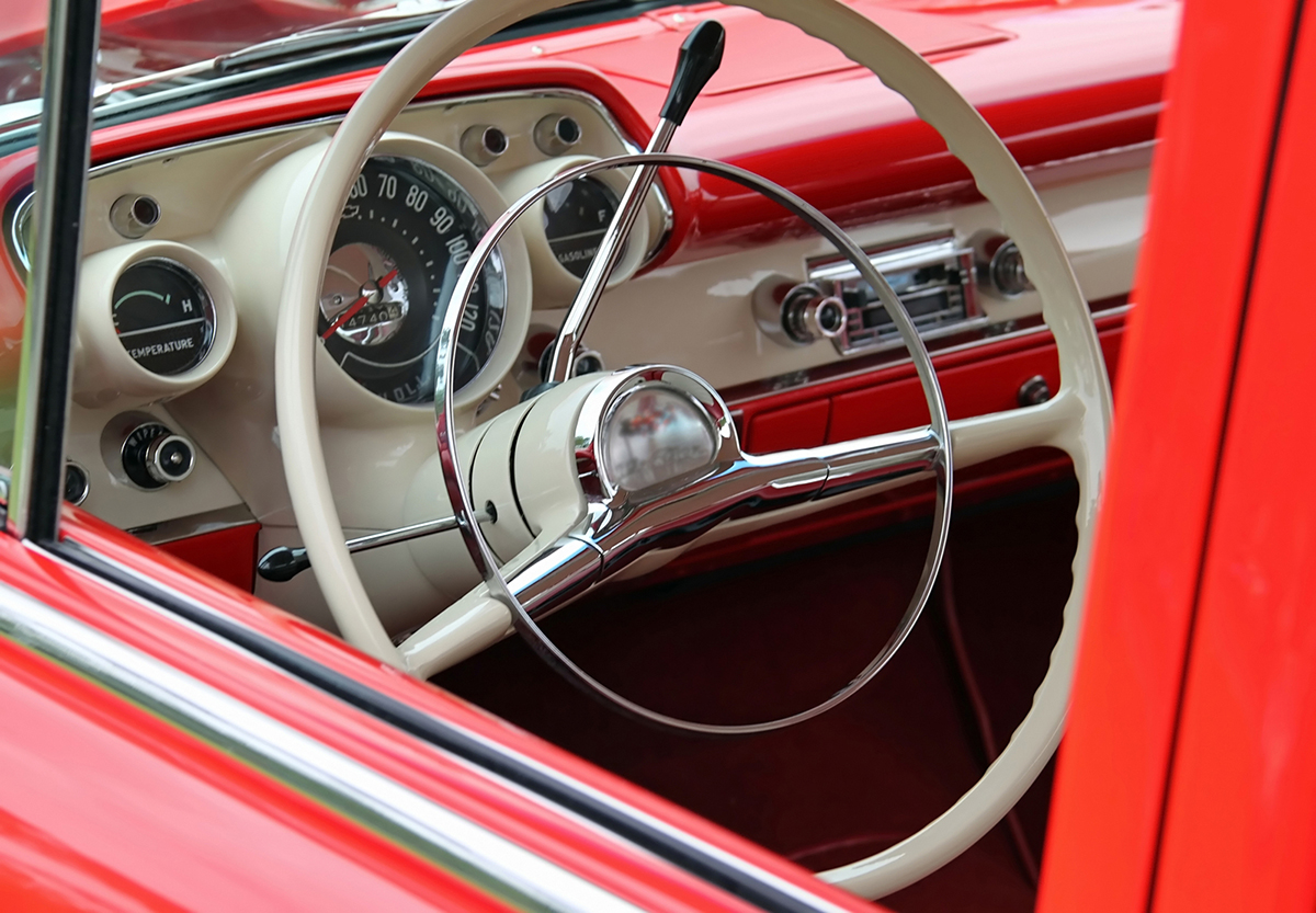 Steering wheel of classic red car
